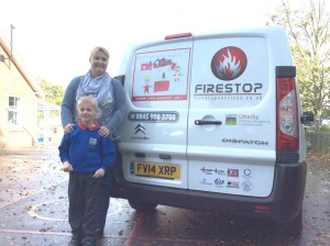 A very proud Lewis Landshoft pictured with Helen Redmond Acting Head of the Academy and his design on a Firestop Services Ltd vehicle.